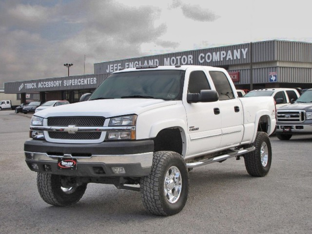 Lifted White Silverado With Rockstars
